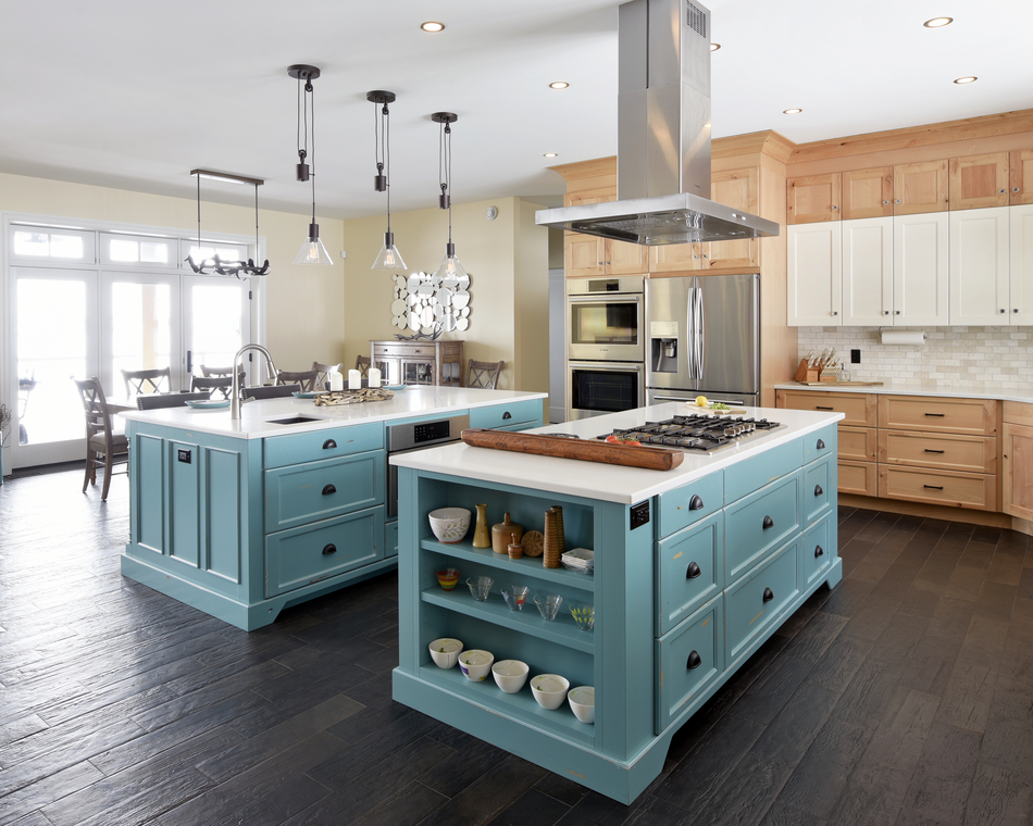 Kitchen with blue center island by Deslaurier